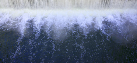 spillway: Dam to regulate the water level in the river. Falling water monochrome with strong bursts Stock Photo