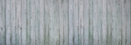 nailed: The texture of weathered wooden wall. Aged wooden plank fence of vertical flat boards.