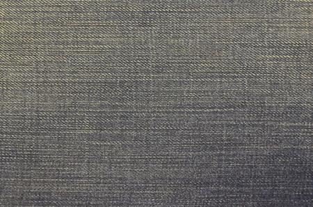 Closeup denim jeans texture. Stitched textured blue denim jeans background. Stock Photo