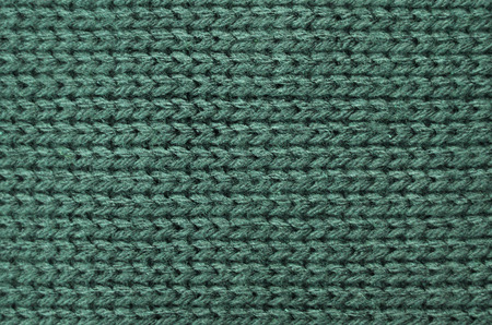 tejido de lana: The texture of a knitted sweater wallpaper. Woolen fabric for wallpaper and an abstract background Foto de archivo