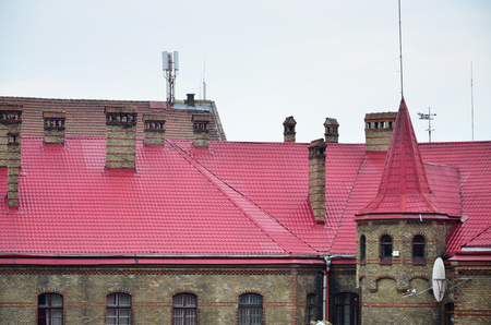 Fragment of a metal roof of the restored old multi-storey building in Lviv, Ukraine