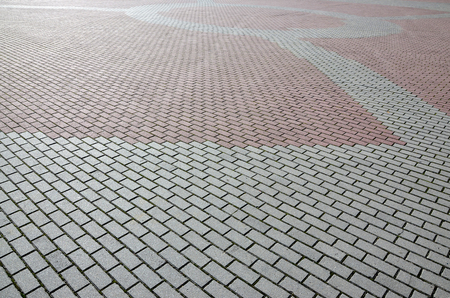 A large area, covered with a quality paving stone in daylight