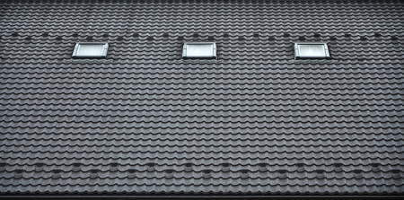 The texture of the roof with a roof made of metal, covered with drops from the rain. Several pane windows are built into the roof Stock Photo