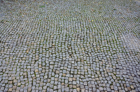 Photo of a platform made of paving stones of a square shape. Top view Banco de Imagens