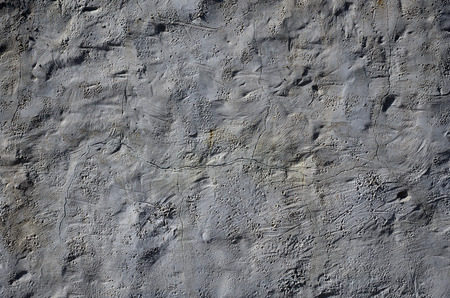 Close up shot of grunge brown clay wall on a old house. The mixture of some other object such as wood and stone