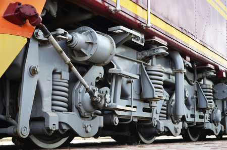 Wheels of a Russian modern locomotive, view from side. Transportation industry concept. Heavy wheels and mechanism under the electro train 報道画像