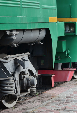 The wheels of a modern Russian electric train with shock absorbers and braking devices. The side of the cab