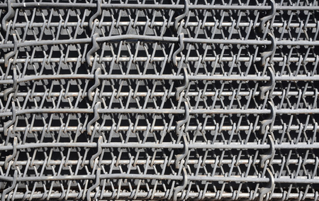 Metal multilayered thick grid of black color. Composite texture