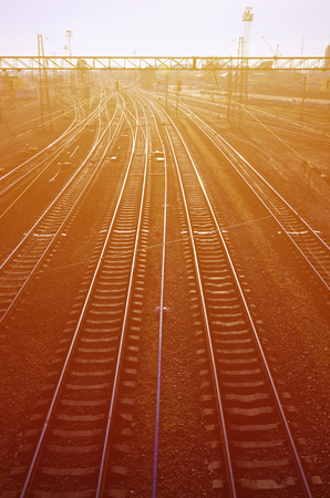 Railway landscape. Empty railway tracks in depot under the open air when the morning light