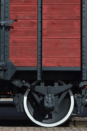 The side of the old brown wooden freight car with the wheel of the times of the Soviet Union Sajtókép