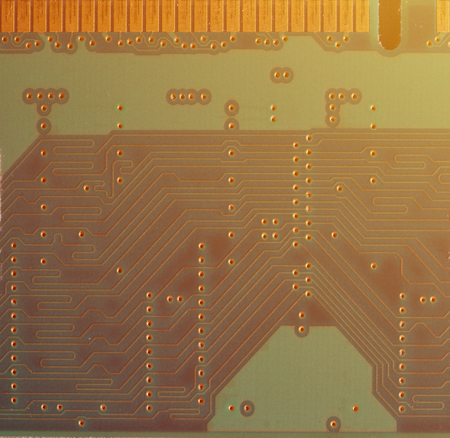 A toned macro image of a computer board with many small technological elements. Extremely shallow depth of field. Abstract technological background Stock Photo
