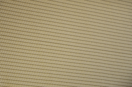 The texture of the roof of painted metal. Close-up detailed view of roof covering for pitched roof. High quality roofing