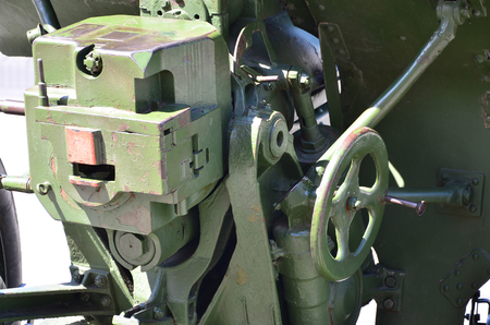 A close-up mechanism of a portable weapon of the Soviet Union of World War II, painted in a dark green color