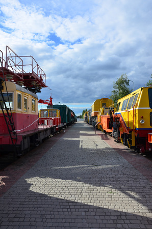 Cabs of modern Russian technical support electric trains and railway cranes. Side view of the heads of railway trains with a lot of wheels Editorial