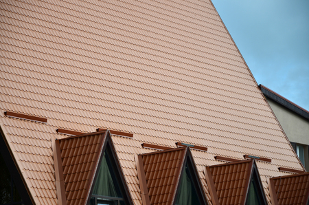 The house is equipped with high-quality roofing of metal tiles. A good example of perfect modern roofing. The building is reliably protected from adverse weather conditions