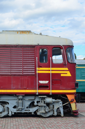 Cabin of modern Russian electric train. Side view of the head of railway train with a lot of wheels and windows in the form of portholes Editorial
