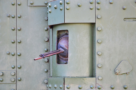 The texture of the wall of the tank, made of metal and reinforced with a multitude of bolts and rivets. Images of the covering of a combat vehicle from the Second World War with a guided machine gun