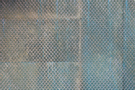 Metal texture with rusty mesh closeup in the daytime outdoors Stock Photo
