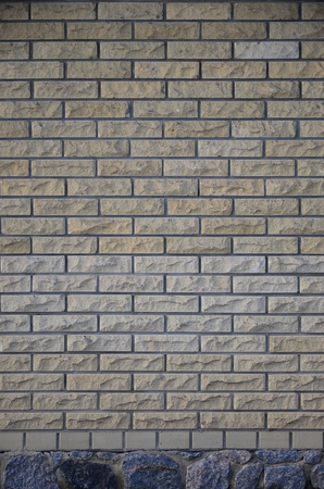 The texture of a dark wall from a variety of old and dirty brick. Detailed pattern of a plurality of different sizes of brick worn out Foto de archivo