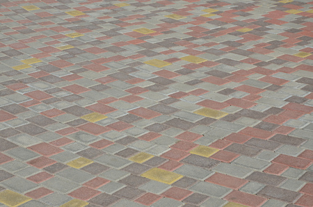 Cobbles texture - hard pavement, a kind of pavement, laid out by flat rectangular (or other shape) bars of approximately the same shape and size 스톡 콘텐츠