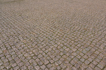 A large area, laid out of paving stone in perspective. Detailed photo of paving stones in the sidewalk avenue close-up Stock Photo