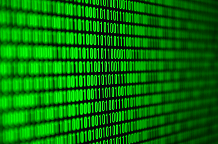 An image of a binary code made up of a set of green digits on a black background Stock fotó