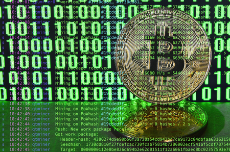 Image of the program code showing the process of mining the crypto currency in the background of the image with bitcoin Stock Photo