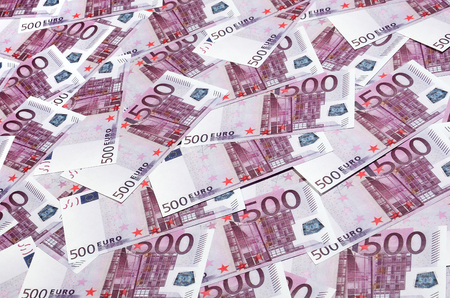 Close up background photo Amount of Five hundred notes of European Union Currency. Many pink 500 euro banknotes are adjacent. Symbolic texture photo for wealth Stock Photo