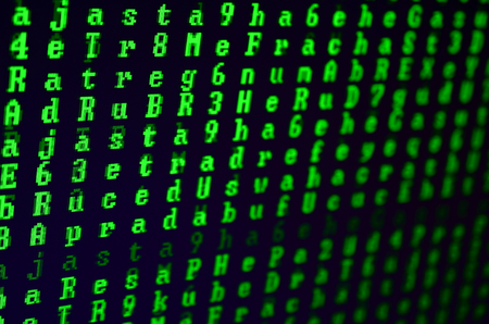 Macro shot of a glitch on the monitor of an office computer. The concept of introducing a virus into a personal data keeper. Stream of random green symbols on a black background Stock Photo