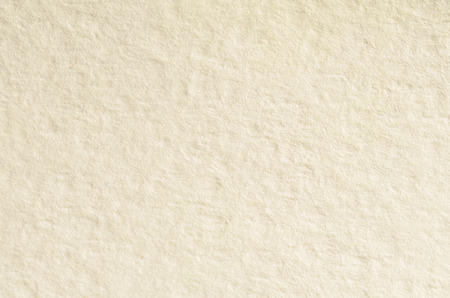 Texture of thick paper intended for watercolor painting. Macro snapshot of details of the relief paper structure