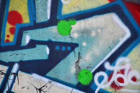 Texture of a fragment of the wall with graffiti painting, which is depicted on it. An image of a piece of graffiti drawing as a photo on street art and graffiti culture topics Reklamní fotografie - 93940137