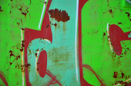 The old wall, painted in color graffiti drawing green aerosol paints. Background image on the theme of drawing graffiti and street art Stock Photo