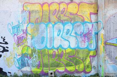 The texture of the wall with graffiti, which is depicted on it. The image of the whole and complete graffiti of the drawing as a resource for the design of 3D projects