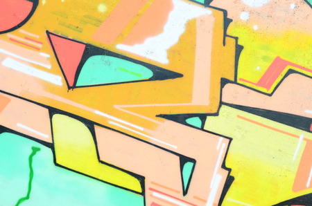 Background image with a colored graffiti pattern, which is applied to the concrete wall with aerosol paints. A lot of contours and fragments filled with paint, forming an interesting composition
