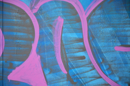 The old wall, painted in color graffiti drawing blue aerosol paints. Background image on the theme of drawing graffiti and street art Stock Photo
