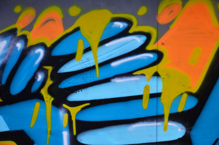 The old wall, painted in color graffiti drawing blue aerosol paints. Background image on the theme of drawing graffiti and street art Stock fotó