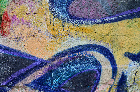 Beautiful street art graffiti. Abstract color creative drawing fashion colors on the walls of the city. Urban Contemporary Culture. Title paint on walls. Culture youth protest Stock Photo
