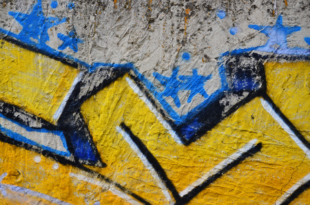 Close up view of graffiti drawing details. Background image on the theme of street art and vandalism. Texture of the wall, painted with aerosol paints Stock Photo