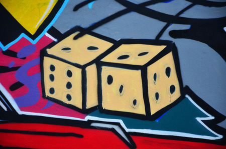 A detailed image of the graffiti drawing. A conceptual street art background with a dice Фото со стока