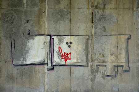 Detailed image of very old and aged color graffiti drawing on the wall. Background grunge street art picture Фото со стока