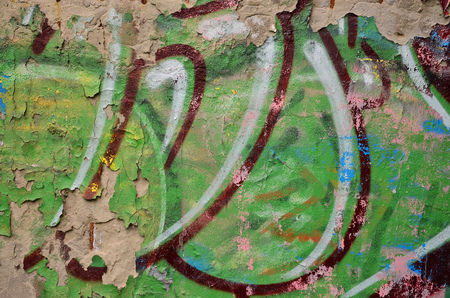 Detailed image of very old and aged color graffiti drawing on the wall. Background grunge street art picture Stock Photo