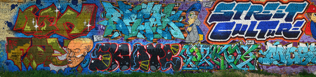 A detailed image of the graffiti drawing. A conceptual street art background with a colorful letter graffiti with word