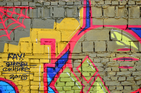 Detailed image of color graffiti drawing. Background street art picture. Part of the colorful masterpiece by the professional graffiti artist