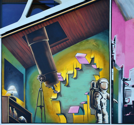 Detailed image of color graffiti drawing. Background Street art background with a painted cosmonaut in the observatory