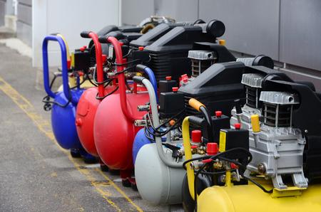 Many new air compressors pressure pumps close up photo Archivio Fotografico