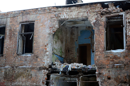 Fragment of an abandoned two-story building after military operations in Donetsk Stock Photo