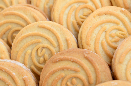 Close-up of a large number of round cookies with coconut filling Stock Photo