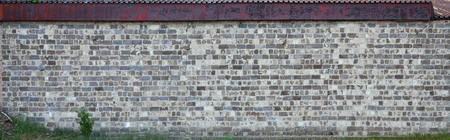 The texture of the warehouse wall from a variety of rough stones of different shades