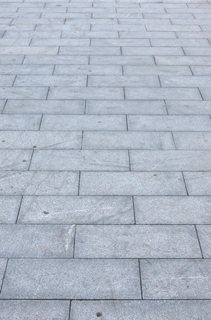 Fragment of the square paved of a large granite tiles Stock Photo