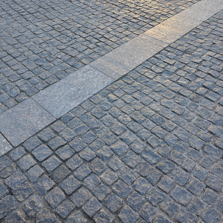 Fragment of the street square, folded out of a gray square paving stone